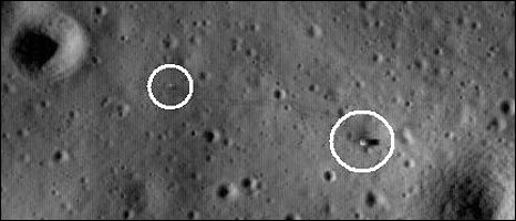 Science instruments (circled left) and the lunar module lower stage (circled right) are connected by a footprint trail