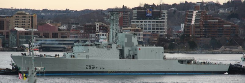 HMCS Athabaskan under tow in Halifax