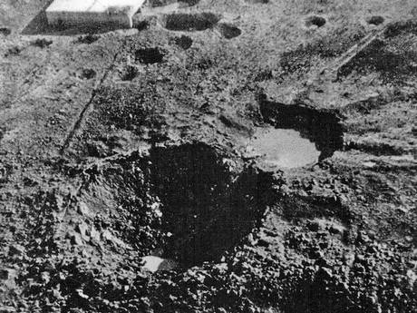 The 70 ft deep and 130 ft diameter crater which Grand Slam created in the New Forest on 13 March 1945 - with the target building in the background (Crown Copyright)