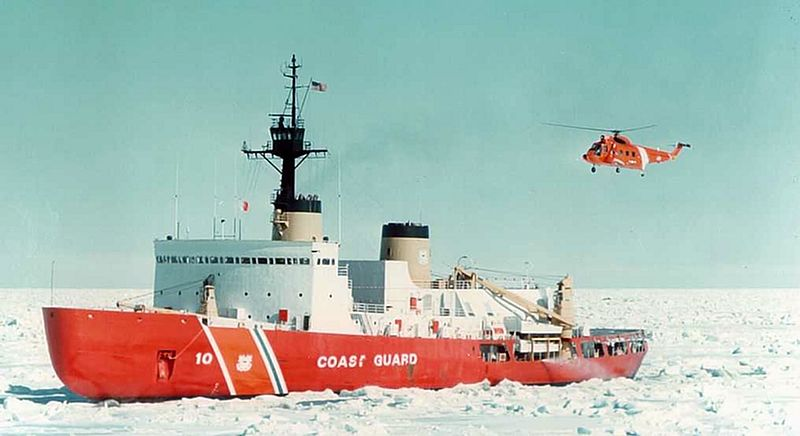 A U.S. Coast Guard HH-52A Seaguard helicopter landing on the icebreaker USCGC Polar Star (WAGB-10).