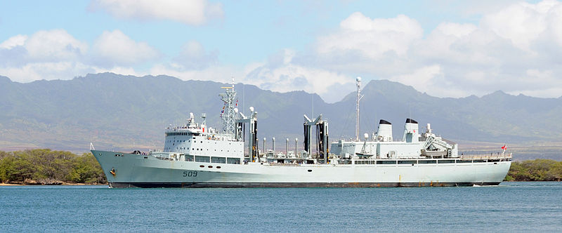 The RCN auxiliary replenishment oiler HMCS Protecteur (AOR 509) departs Naval Station Pearl Harbor after a routine port visit. Protecteur provides Canadian and allied warships with fuel, food and supplies and is the only Canadian Navy supply ship stationed on the Pacific Coast.