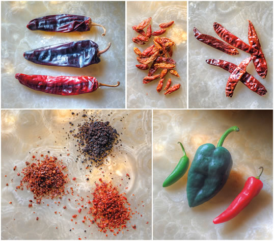 "Dried chiles shipped well worldwide. From top-left: New World Capsicum annuum varieties include guajillo, ancho and New Mexico; a smaller Capsicum frutescens variety called ""birdseye"" chiles spread wild in Africa after birds spread their seeds from early gardens, and they are now common also in Southeast Asia; ""Indian"" chiles are among the most common varieties in India, which today grows and exports more chiles than any other nation. Bottom-left: Three popular capsicum peppers that took root in the Middle East—Maraş, Urfa and Aleppo, shown below in their flaked form—are used in dishes throughout the region. Bottom-right: Fresh serrano, poblano and ripe jalapeño peppers."
