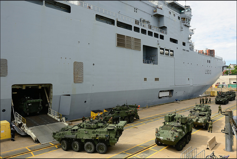 Members of the 1st Battalion, Royal 22e Regiment load light armored vehicles onboard the French Navy amphibious ship Mistral as part of Exercise LION MISTRAL 2014 in Halifax, Nova Scotia, June 17, 2014. Photo: MCpl Patrick Blanchard, Canadian Forces Combat Camera IS2014-3030-06