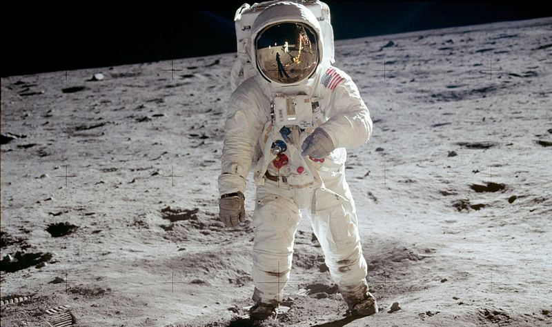 "Astronaut Buzz Aldrin, lunar module pilot, stands on the surface of the moon near the leg of the lunar module, Eagle, during the Apollo 11 moonwalk. Astronaut Neil Armstrong, mission commander, took this photograph with a 70mm lunar surface camera. While Armstrong and Aldrin descended in the lunar module to explore the Sea of Tranquility, astronaut Michael Collins, command module pilot, remained in lunar orbit with the Command and Service Module, Columbia. *This is the actual photograph as exposed on the moon by Armstrong. He held the camera slightly rotated so that the camera frame did not include the top of Aldrin's portable life support system (""backpack""). A communications antenna mounted on top of the backpack is also cut off in this picture. When the image was released to the public, it was rotated clockwise to restore the astronaut to vertical for a more harmonious composition, and a black area was added above his head to recreate the missing black lunar ""sky"". The edited version is the one most commonly reproduced and known to the public, but the original version, above, is the authentic exposure."