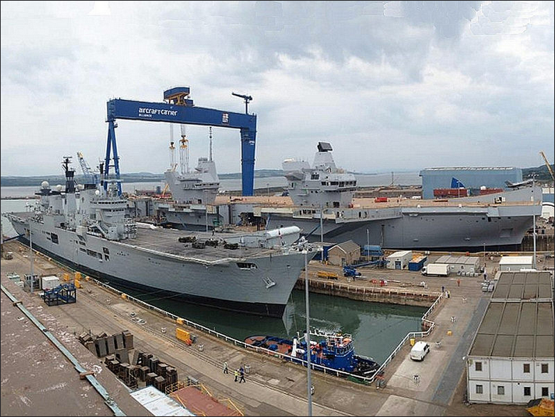 HMS Queen Elizabeth ready for christening, with HMS Illustrious in the foreground. (Photo by Jeff Head)