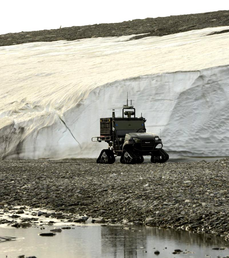 At CFS Alert, the Multi-Agent Tactical Sentry (MATS) UGV travels through rough Arctic terrain during an autonomous path-following test without the use of GPS. The Canadian Armed Forces Joint Arctic Experiment (CAFJAE) 2014 tests autonomous technology for Arctic conditions and explores its potential for future concepts of military operations through experiments carried out August 2014 at Canadian Forces Station Alert, Nunavut.  CAF and Defence Research and Development Canada's (DRDC) JAE work will benefit multiple government partners and centers around a fictitious satellite crash with hazard identification, telecommunication and other search and rescue tasks.