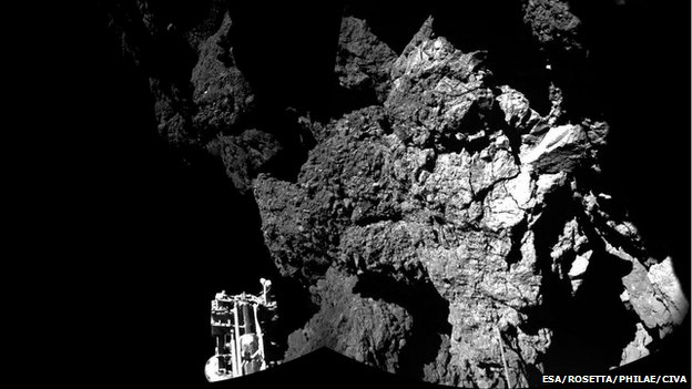 The craggy surface of the comet - looking over one of Philae's feet