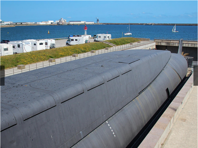 The 16 missile hatches, with the lovely Cherbourg harbor in the background.