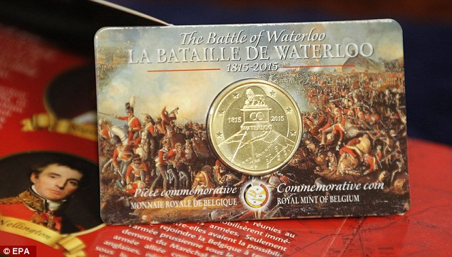 The new Belgian coin in its decorative holder. Click to see the original image at the Daily Mail.