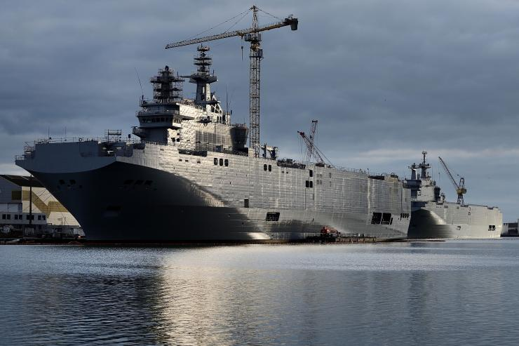 The Sevastopol (left) and the Vladivostok warships, two Mistral class LHD amphibious vessels ordered by Russia from STX France, are seen in St. Nazaire, France, Dec. 20, 2014. Jean-Sebastien Evrard/Agence France-Presse/Getty Images